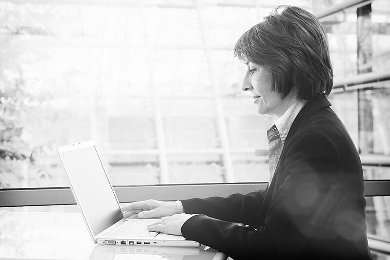 Senior businesswoman working with laptop at office.