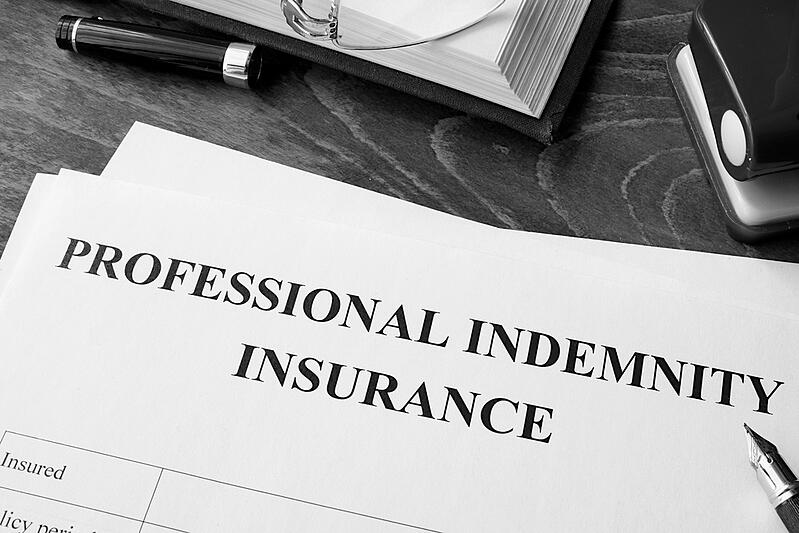professional indemnity insurance policy papers on an office desk