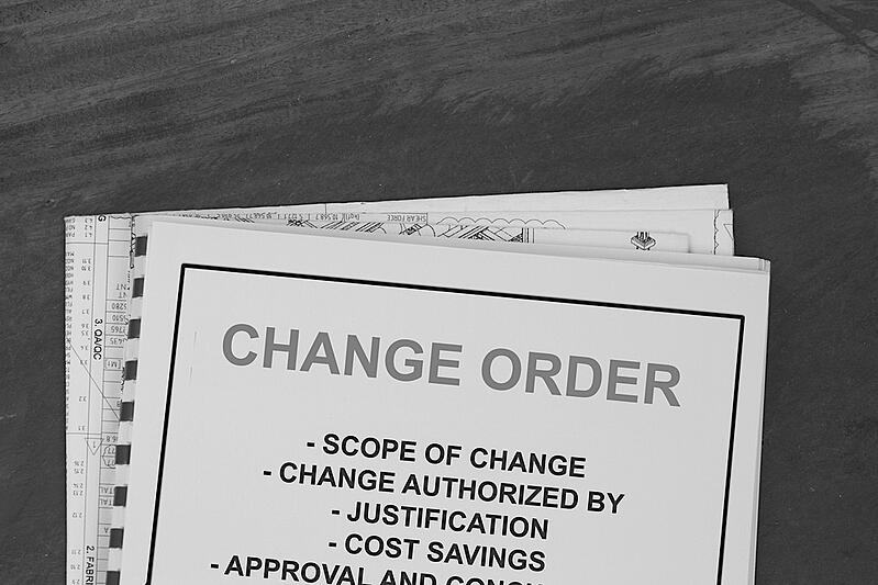 change order papers on desk describing scope of change and authorization