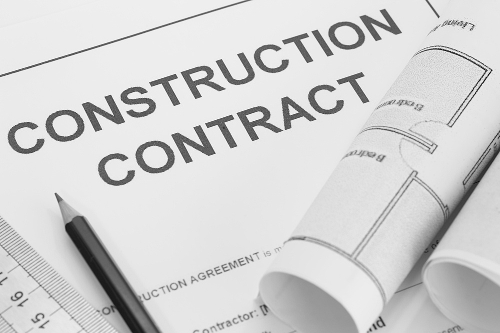 construction contract with pencil and ruler