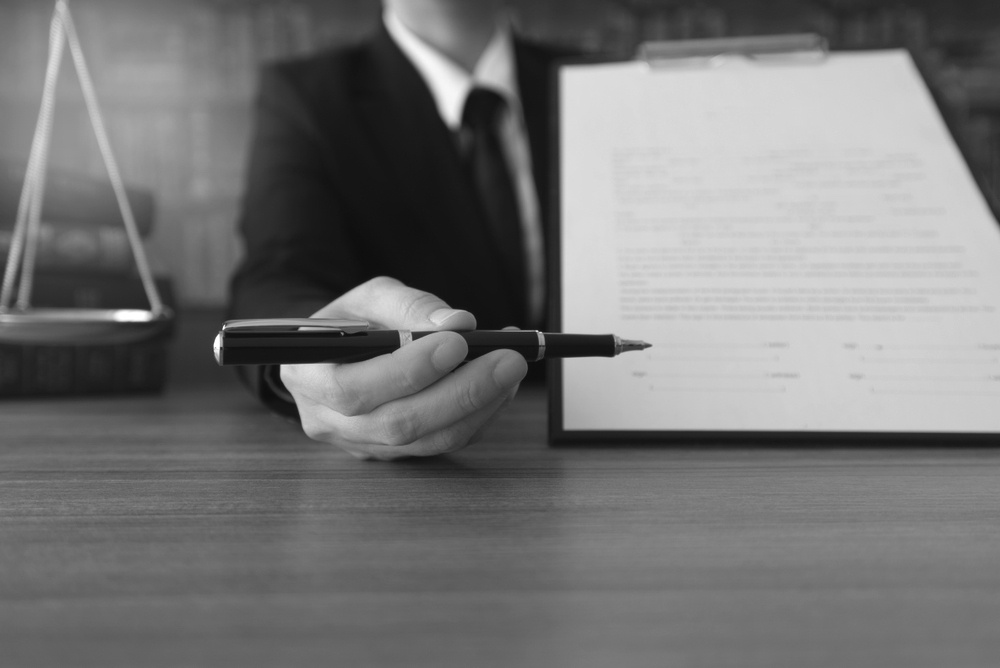 business man holding pen and pointing at construction contract