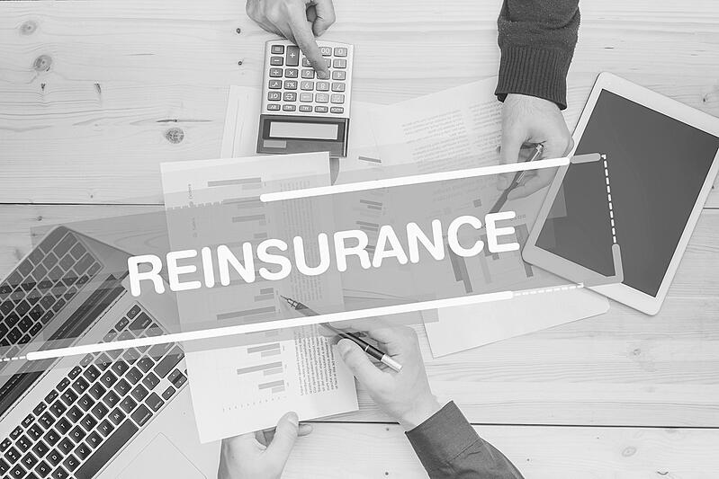 business insurance meeting with text that reads reinsurance