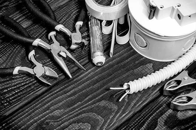 Construction workers tools on a wooden surface