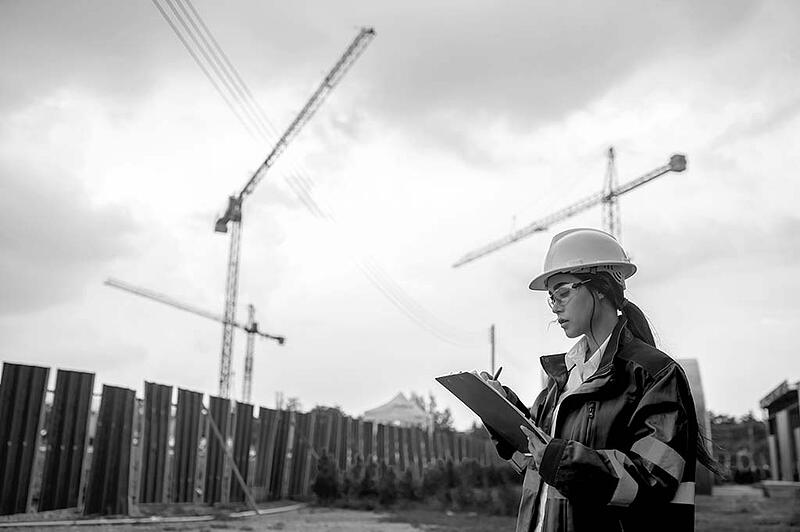 Engineer working at site of a large building project