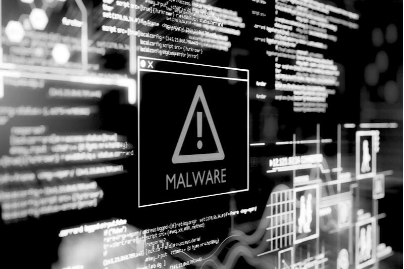 Malware notification on a computer screen with html code running in the background.