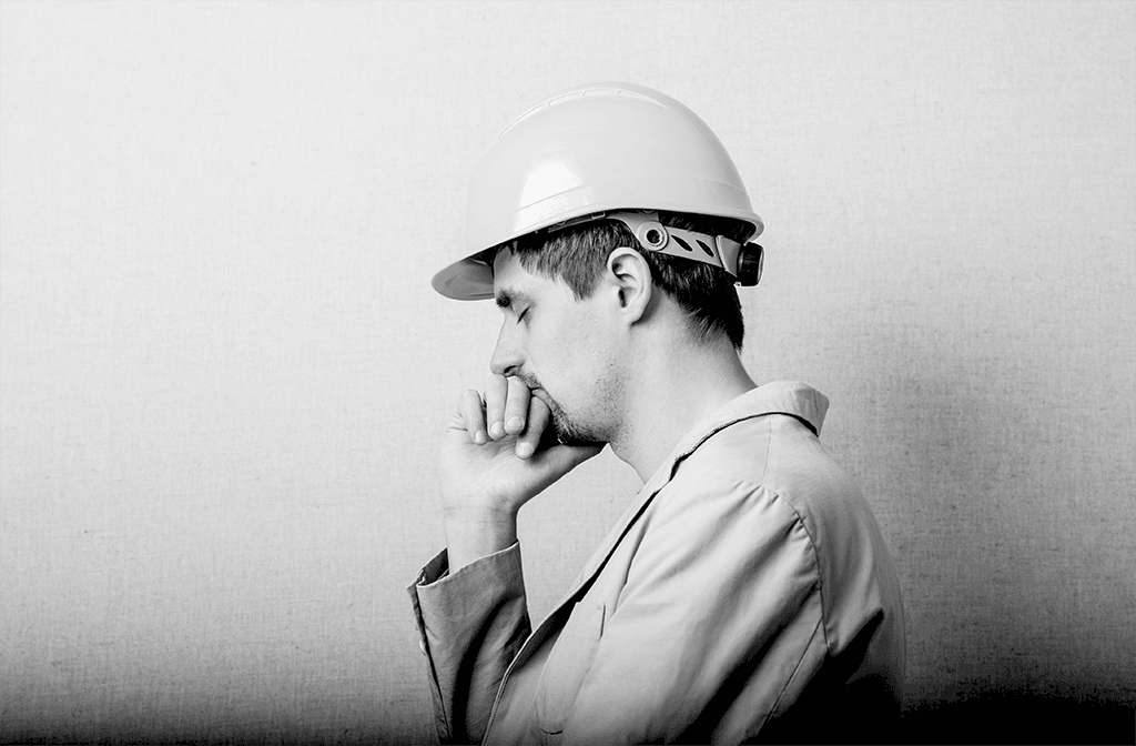 Construction worker with hard hat profile shot mental health wellbeing image