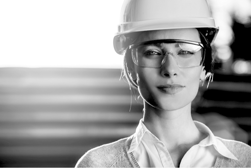 Woman in construction hat with safety googles